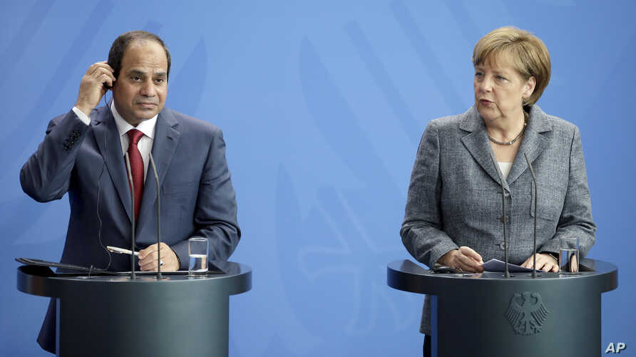 German Chancellor Angela Merkel, right, and the President of Egypt Abdel Fattah el-Sissi address the media during a joint press conference as part of a meeting at the chancellery in Berlin, Germany, June 3, 2015.