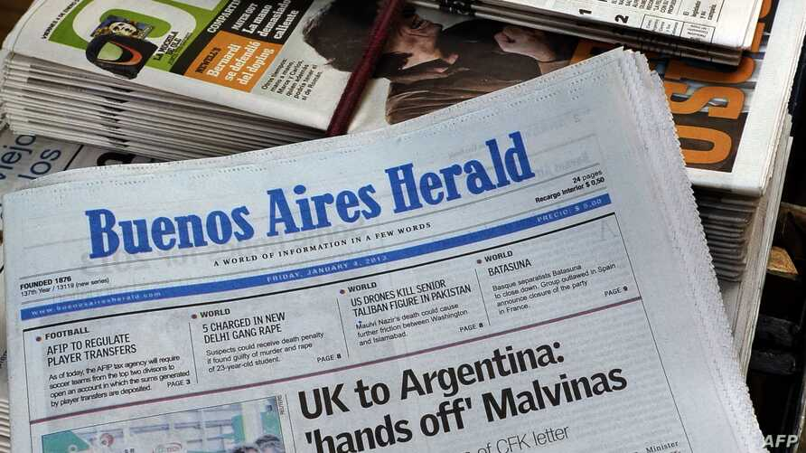 """Picturte of the front page of the Buenos Aires Herald in which Britain's biggest-selling tabloid The Sun placed an advert warning Argentina to keep its """"hands off"""" the Falklands, taken at a newsstand in Buenos Aires, Jan. 4, 2013."""
