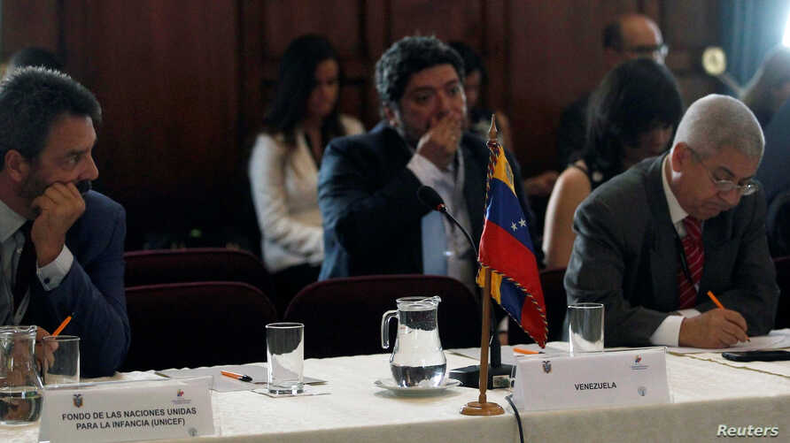 The empty place of the representative of Venezuela is seen during a regional summit to discuss a worsening exodus of migrants fleeing Venezuela and overwhelming South American countries, in Quito, Ecuador, Sept. 3, 2018.