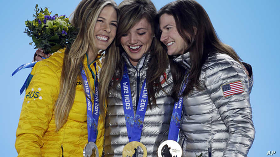 Women's snowboard halfpipe medalists, from left, Torah Bright of Australia, silver, Kaitlyn Farrington of the United States, gold, and Kelly Clark of the United States, bronze, pose with their medals at the 2014 Winter Olympics in Sochi, Feb. 13, 201