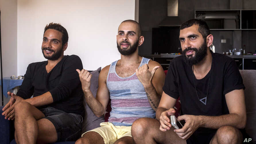 "This July 27, 2015 photo shows Khader Abu Seif, from left, Naeem Jiryes and Fadi Daeem, protagonists of the documentary movie ""Oriented"" during an interview with The Associated Press in Jaffa, mixed Jewish-Arab part of Tel Aviv, Israel."