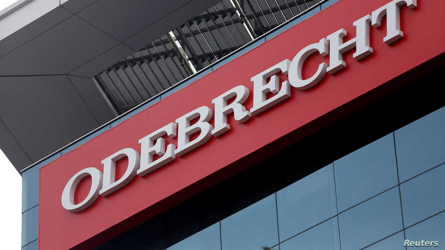 File - A sign of the Odebrecht SA construction conglomerate is pictured in Lima, Peru, June 28, 2016.