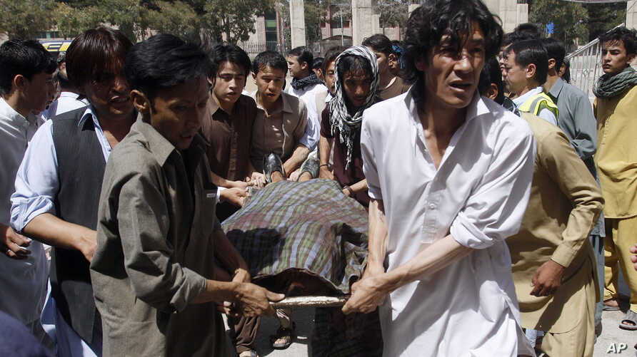 Pakistani Shiite Muslims carry the body of a person killed by gunmen at a local hospital in Quetta, Pakistan. A group of gunmen on motorcycles in the southwestern province of Baluchistan killed several Shiite Muslims, as violence against the minority