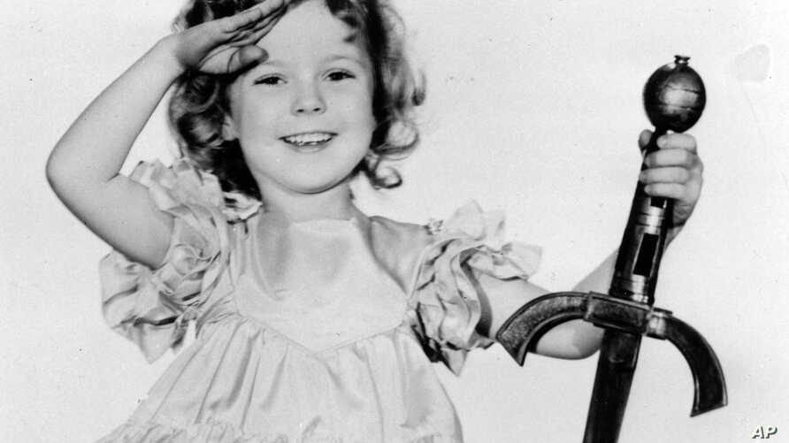 """FILE - In this 1933 file photo, Shirley Temple is seen in her role as """"Little Miss Marker."""""""