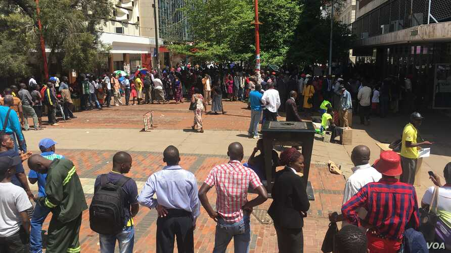 Long and winding queues have remained at almost all banks Zimbabwe confirming that the country's one-year-old shortages of cash seem to be far from over despite the country introducing its currency, the bond notes that trade at par with the U.S. doll