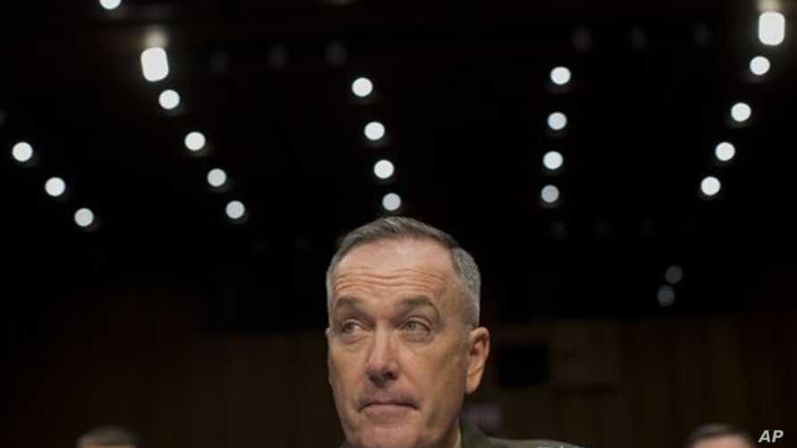 General Joseph Dunford, Commander of U.S.-led forces in Afghanistan, testifies on Capitol Hill, March 12, 2014.