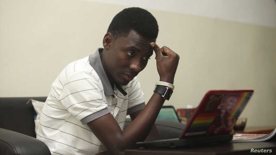 Rashidi Williams, a gay man, works on his laptop in Lagos, Nigeria, in this Nov. 17, 2011 photo.