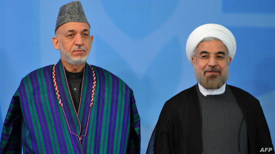 Afghanistan's  President Hamid Karzai (L) and Iran's Presi