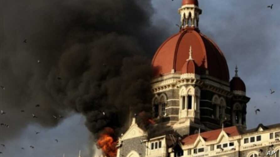 This file photograph taken on 27 Nov 2008 shows flames gushing out of The Taj Mahal Hotel in Mumbai, one of the sites attacked by alleged militant gunmen