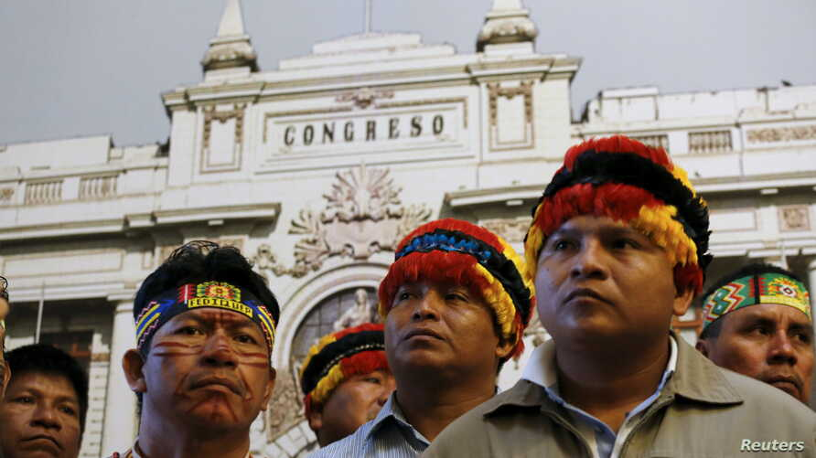 FILE - Chiefs of indigenous communities of the Amazonas attend a news conference in Lima, Aug. 13, 2015. Indigenous communities near Peru's biggest oil field, block 192, pressed for better benefits and environmental monitoring.