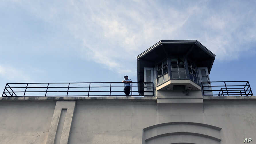 FILE - A guard stands on the wall of Clinton Correctional Facility on June 13, 2015, in Dannemora, New York.