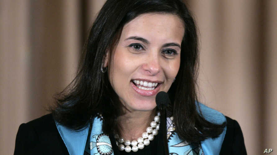 FILE - Dina Powell, Assistant Secretary for Educational and Cultural Affairs, speaks at the State Department, Jan. 6, 2006 in Washington.