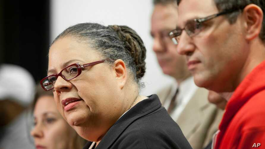 Chicago Teachers Union President Karen Lewis, left, answers reporters' questions at a news conference following a meeting of CTU delegates Sunday, Sept. 16, 2012 in Chicago.