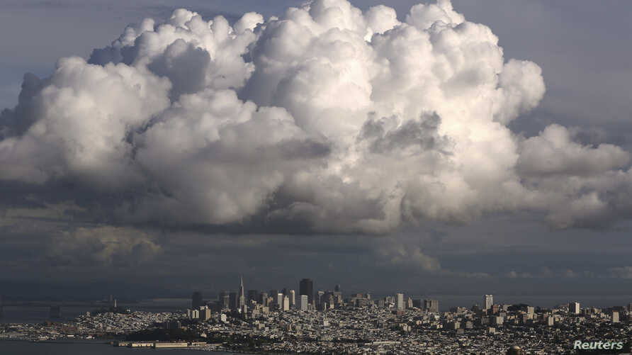 A large cloud gathers over the skyline of San Francisco, California Dec. 12, 2014. While the Pacific Northwest is expected to have a mild winter, California's forecast is unsure.