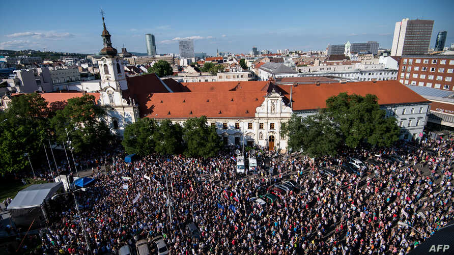 Demonstrators hold up flags of Slovakia and EU during an anti-corruption rally in Bratislava, Slovakia, June 5, 2017.