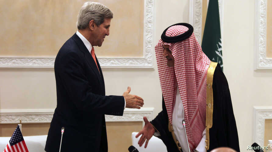 U.S. Secretary of State John Kerry (L) shakes hands with Saudi Foreign Minister Prince Saud al-Faisal at the end of a joint news conference in Riyadh, Saudi Arabia, Nov. 4, 2013.