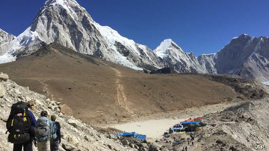 This April 10, 2016 photo shows trekkers heading to Everest Base Camp, Nepal.