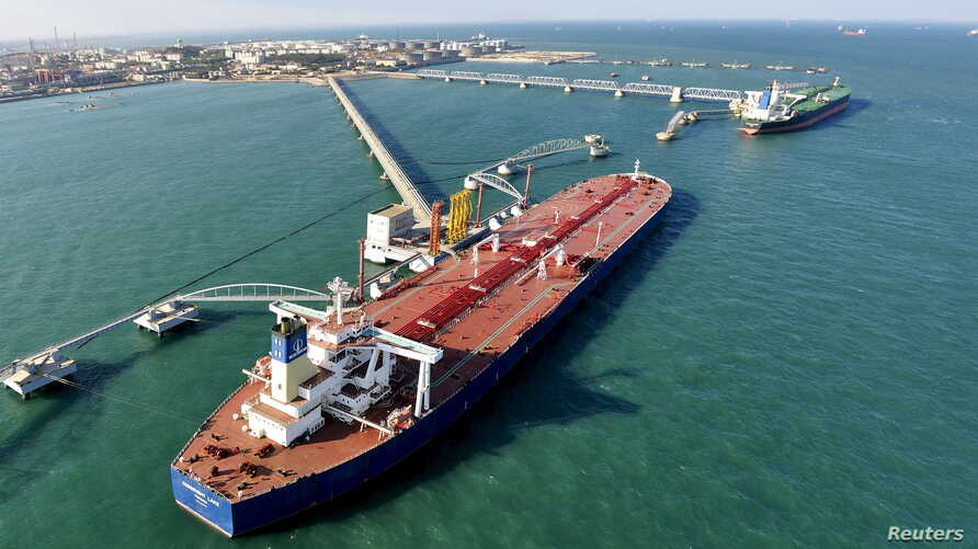 FILE - A crude oil importing port in Qingdao, Shandong province, China.