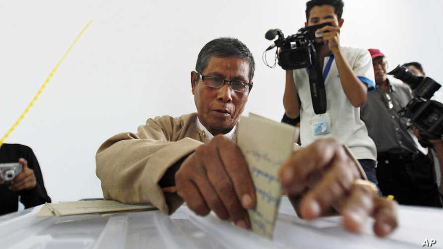 Officers of Union Election Commission transfer ballots that were cast in advance in foreign countries by Myanmar citizens as representatives of various political parties watch on in Naypyitaw, Myanmar, Tuesday, Nov. 3, 2015.