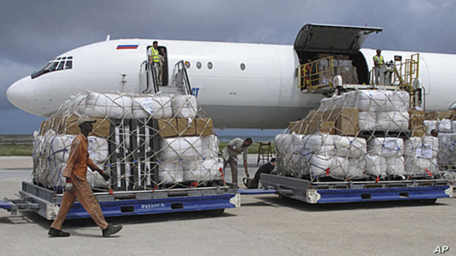 Tons of relief from UNHCR is offloaded after landing in Mogadishu airport Somalia, August 8, 2011