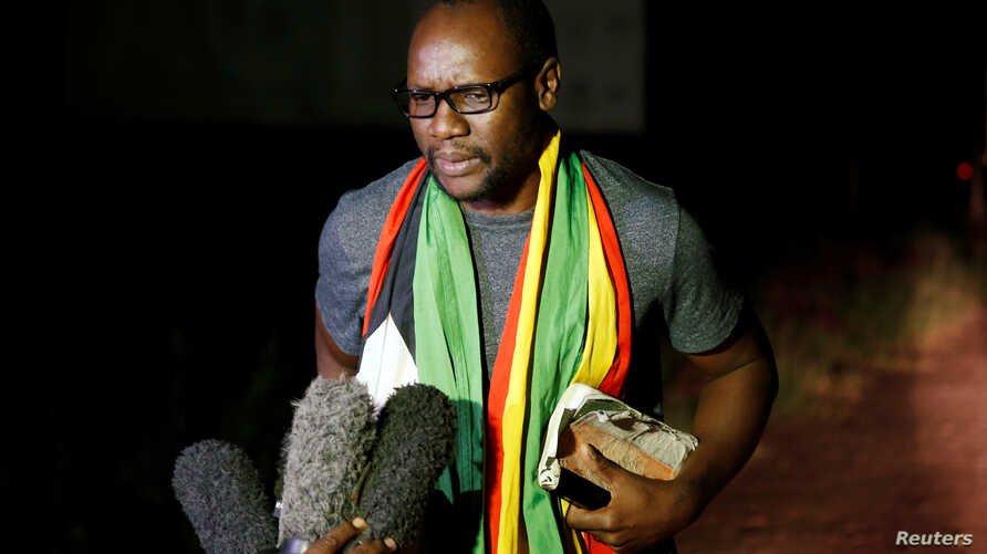 Activist pastor Evan Mawarire speaks to members of the media after he was released on bail from Chikurubi Maximum Prison in Harare, Zimbabwe, Jan. 30, 2019.