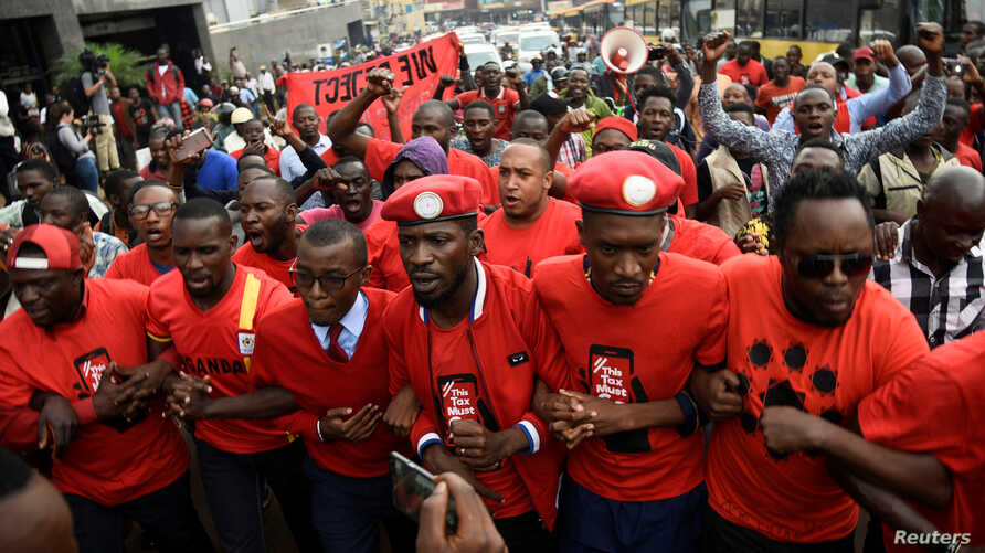 Ugandan musician turned politician, Robert Kyagulanyi (C) leads activists during a demonstration against new taxes including a levy on access to social media platforms in Kampala, July 11, 2018.