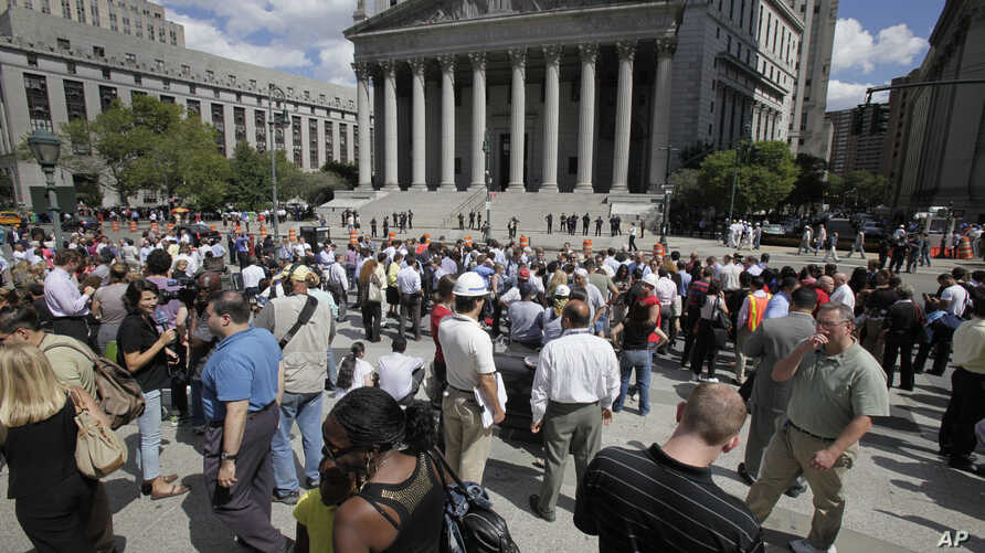 East Coast Quake: People stand in Foley Square in New York after being evacuated from the Federal and State buildings that surround it Tuesday, Aug. 23, 2011. The 5.8 magnitude earthquake centered northwest of Richmond, Va., shook much of Washington,