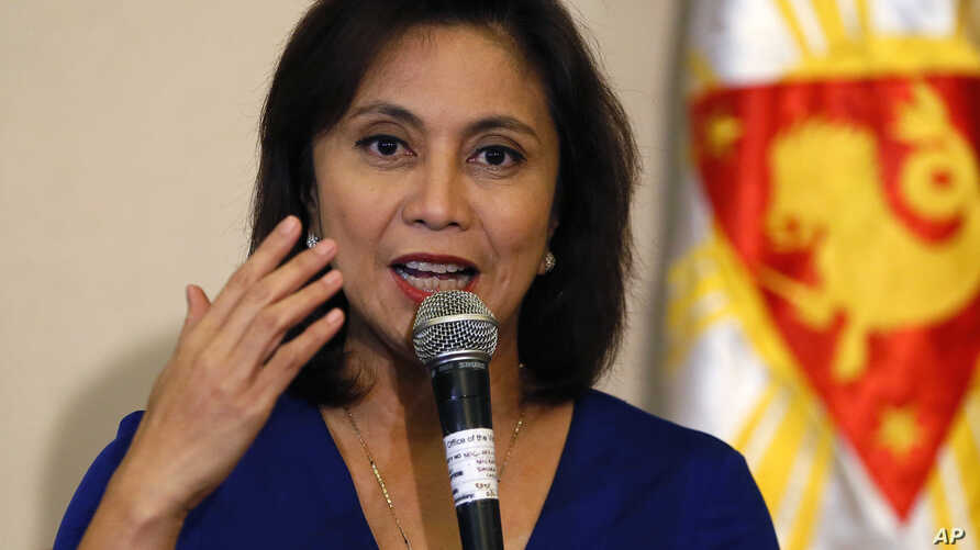 FILE - In this Dec. 5, 2016 file photo, Philippine Vice President Leni Robredo answers questions from the media during a news conference following her resignation from her cabinet post under President Rodrigo Duterte in suburban Quezon city, south of
