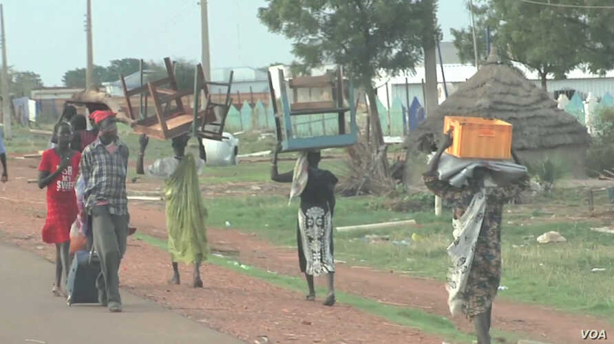 Residents of the South Sudanese town of Bentiu flee toward the U.N. base after fresh fighting and targeted killings rocked the town.