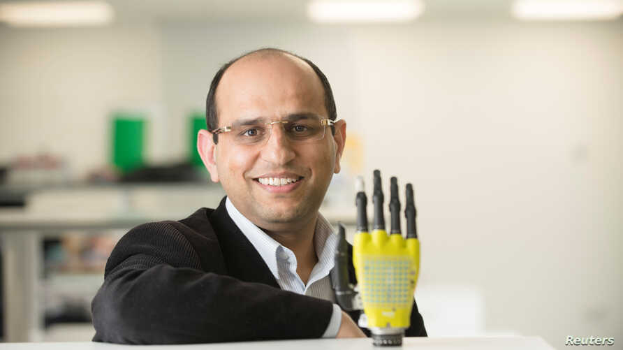 Ravinder Dahiya of the University of Glasgow's School of Engineering poses with the prosthetic hand developed by his team at Glasgow University, Scotland, March 11, 2017.