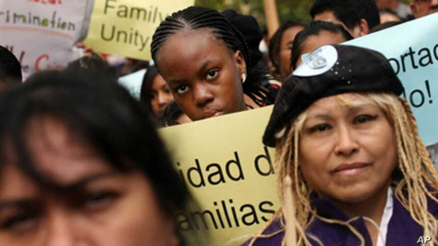 Immigrant rights supporters attend a pro-immigration rally in New York City, 19 Oct 2010