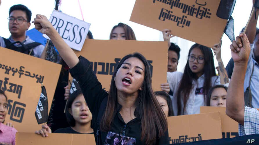 Activists protest the jailing of two Reuters journalists jailed on charges of possessing state secrets in connection with their reporting about massacres against Rohingya Muslims, Sept.16, 2018.