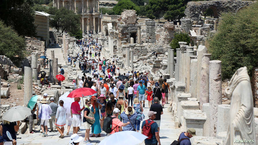 FILE - Tourists visit the ancient city of Ephesus near Izmir in the western Aegean region, Turkey, Aug. 5, 2018.