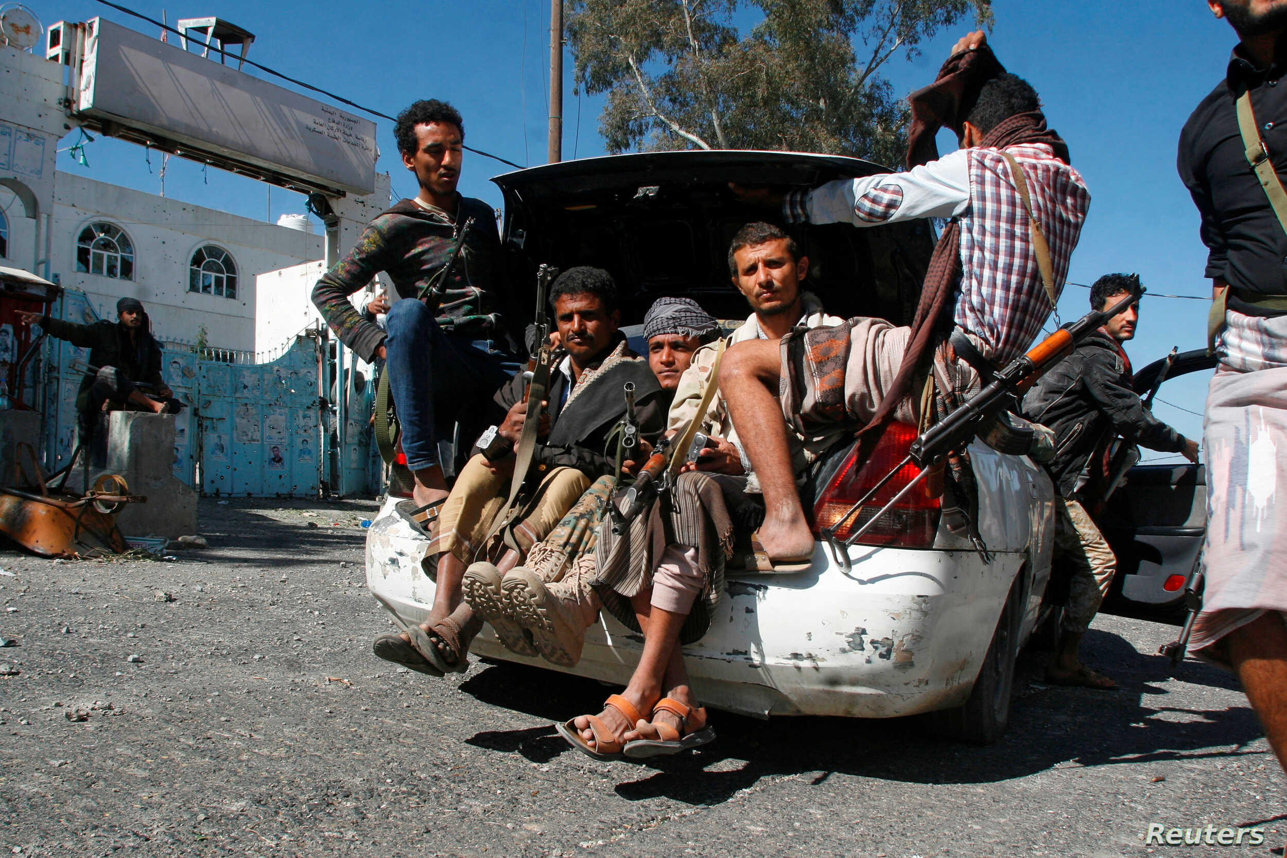 Pro-government fighters ride in the trunk of a car in the southwestern city of Taiz, Yemen, Nov. 21, 2016.