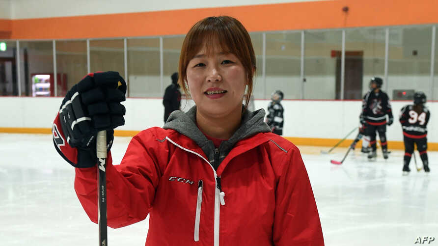 Former North Korean ice hockey player Hwangbo Young, center, coaches an ice hockey class for children at an ice rink in Seoul. When the North and South Korean women's hockey teams clash in a rare match this week, defector-turned-star-player Hwangbo