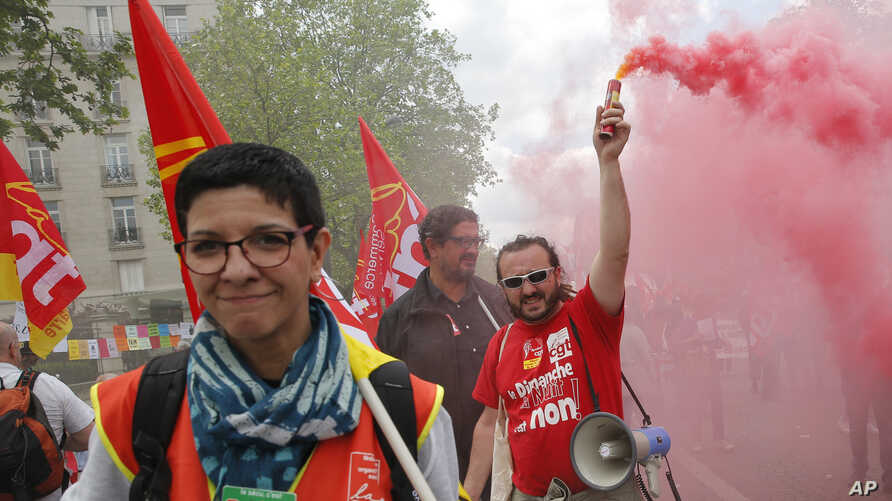 France Labor ProtestsUnion members march during a rally in Paris, May 17, 2016. Truckers blocked French highways and workers marched through city streets Tuesday to protest a new labor bill they claim is unfriendly to workers.