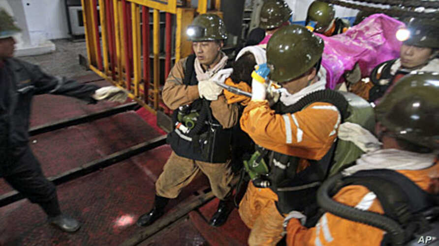 Rescuers carry a survivor out of the Qianqiu coal mine after a rock burst incident in Sanmenxia, Henan province, November 4, 2011