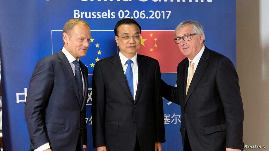 From left, European Council President Donald Tusk, Chinese Premier Li Keqiang and EU Commission President Jean-Claude Juncker pose during an EU-China summit in Brussels, Belgium, June 2, 2017.