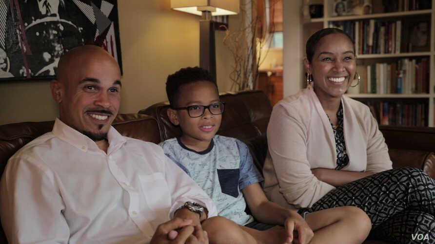 Jeremy Randall and Ariam Mohamed are experiencing their first Ramadan together as newlyweds. Jeremy's son, Jeremiah, 10, is not Muslim. He says he tries not to tempt them during their fasts. (B. Aboud/VOA)