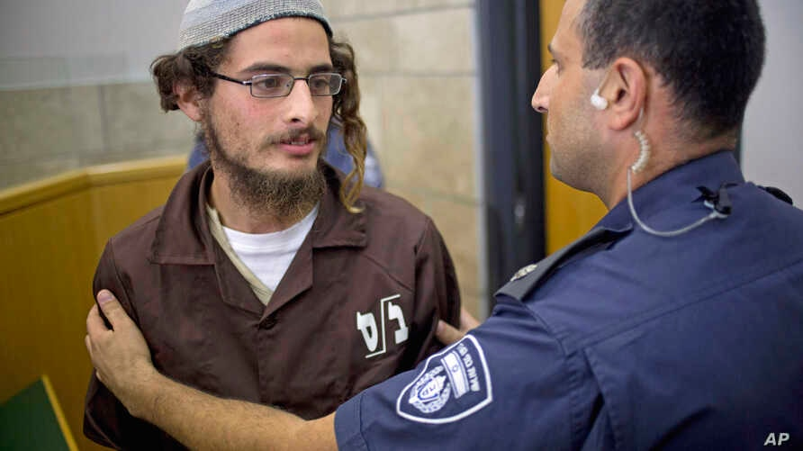 Head of a Jewish extremist group Meir Ettinger appears in court in Nazareth Illit , Israel,  Aug. 4, 2015.