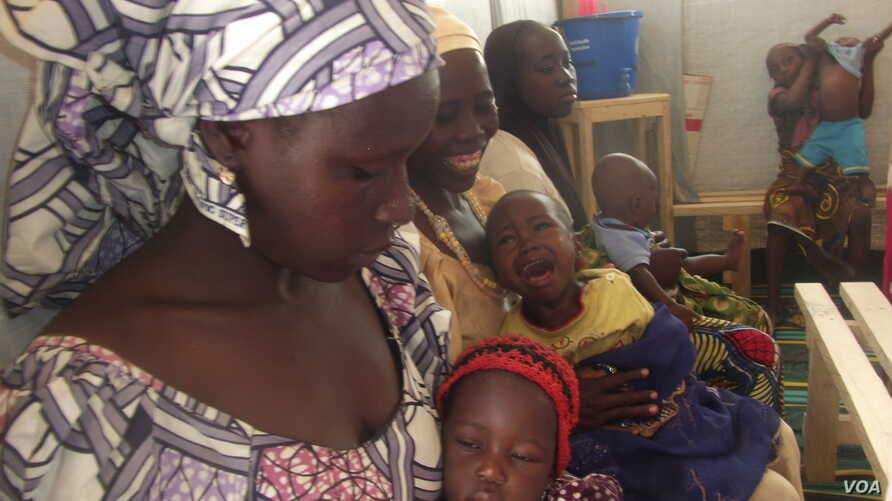 Aissatou Jowel, left, lives with her children at the refugee camp in Minawao, Cameroon. She says it would be too painful to return to her home in northern Nigeria, where Boko Haram rebels killed her husband. (Moki Edwin Kinzeka / VOA)