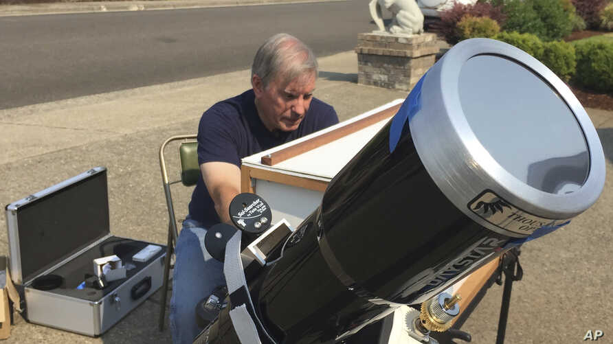 Amateur astronomer Mike Conley practices with the telescope he will use to document the Aug. 21 total solar eclipse, at his home in Salem, Ore., Aug. 3, 2017. Conley is part of a project led by the National Solar Observatory to have dozens of citizen...