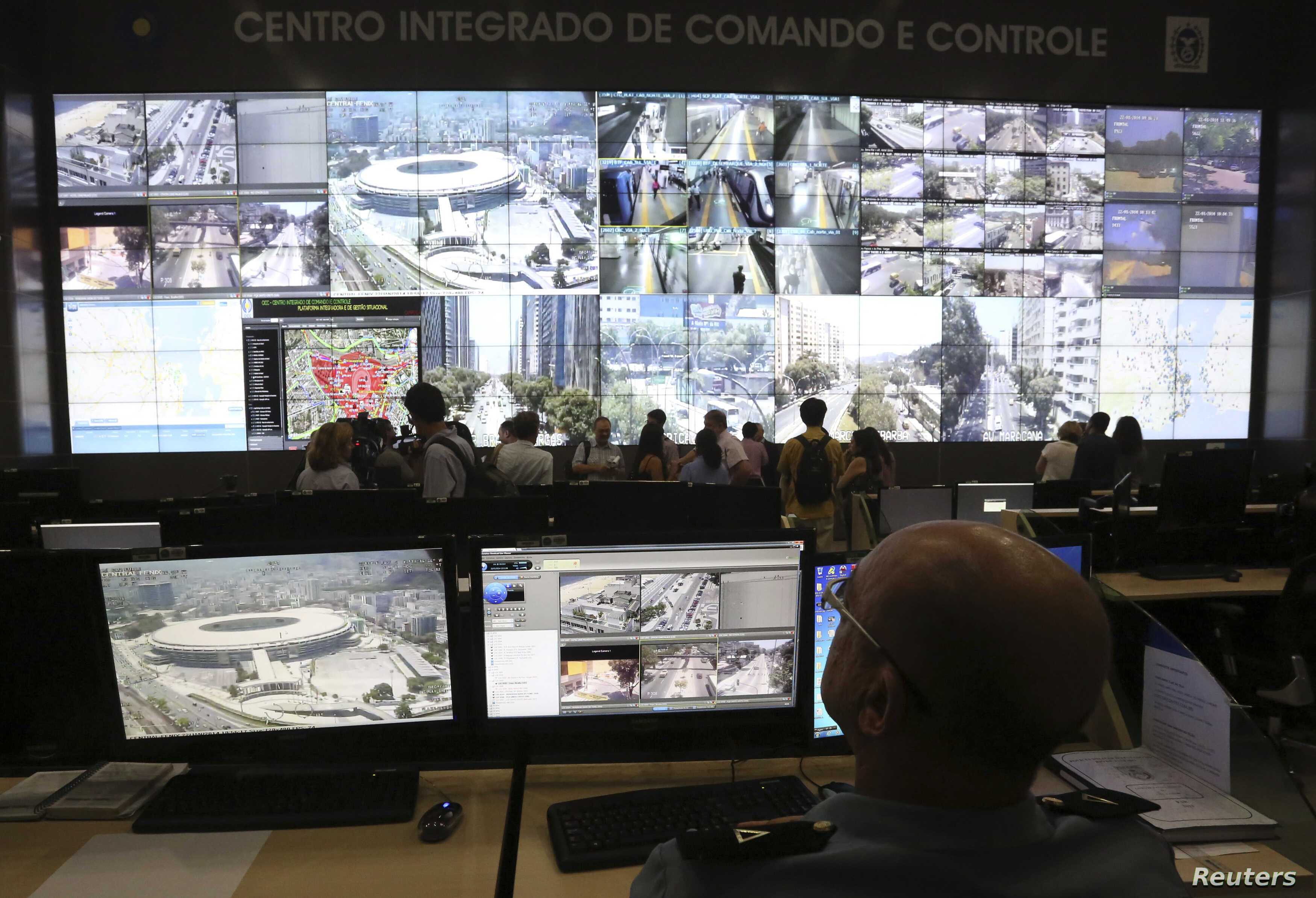 A policeman observes a screen displaying the Maracana stadium during a media tour at the security center for the 2014 soccer World Cup in Rio de Janeiro, Jan. 22, 2014.
