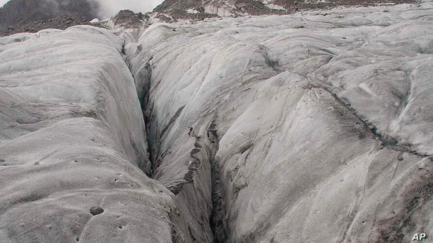 FILE -An ice crevasse is seen on the Baishui Glacier No. 1, the world's fastest melting glacier due to its proximity to the Equator, on the Jade Dragon Snow Mountain in the southern province of Yunnan in China, Sept. 22, 2018.