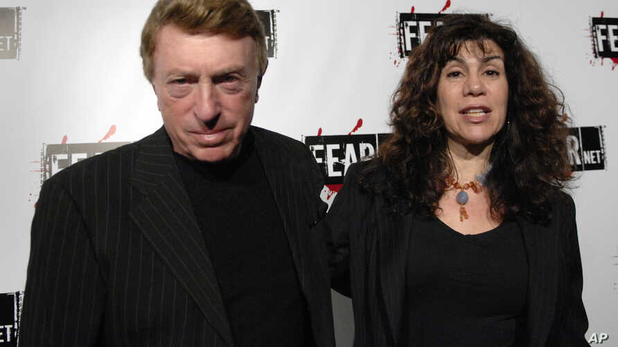 FILE - writer, director Larry Cohen, left, and wife Cynthia Cohen arriving for the Comcast, Sony and Lionsgate launch party for FEARnet, a multi-platform network dedicated to horror, held at the Boulevard 3 nightclub in Los Angeles, Oct. 30, 2006.
