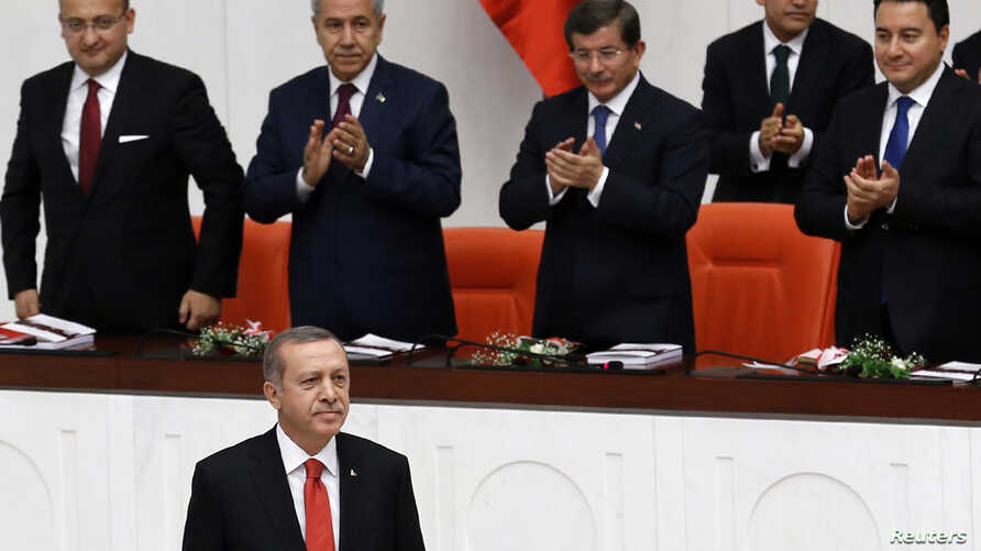 Turkey's President Recep Tayyip Erdogan, lower left, attends a debate marking the reconvening of parliament after a summer recess at the Turkish Parliament in Ankara, Oct. 1, 2014.