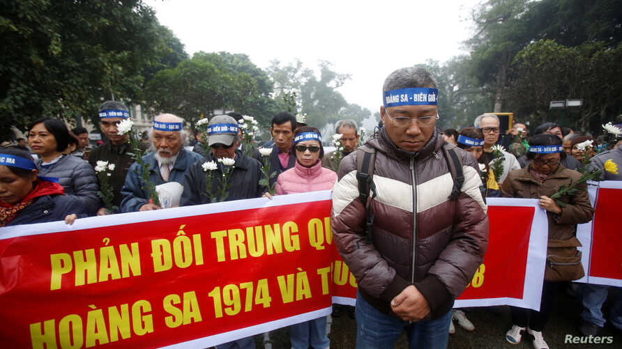 People take part in an anti-China protest to mark the 43rd anniversary of the China's occupation of the Paracel Islands in the South China Sea in Hanoi, Vietnam, Jan. 19, 2017.