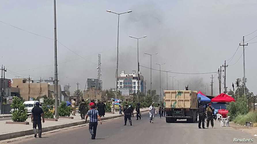 Smoke rises from a car bomb attack in the Saydiya district of southern Baghdad, May 2, 2016.
