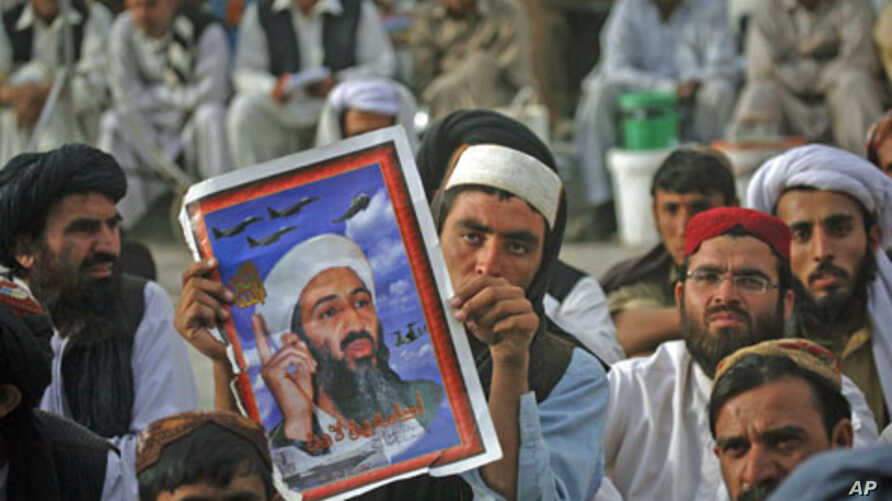 Supporters of Pakistani religious party Jamiat-e-Ulema-e-Islam hold an image of al-Qaida leader Osama bin Laden during an anti-American rally in Quetta, Pakistan, May 2, 2012.