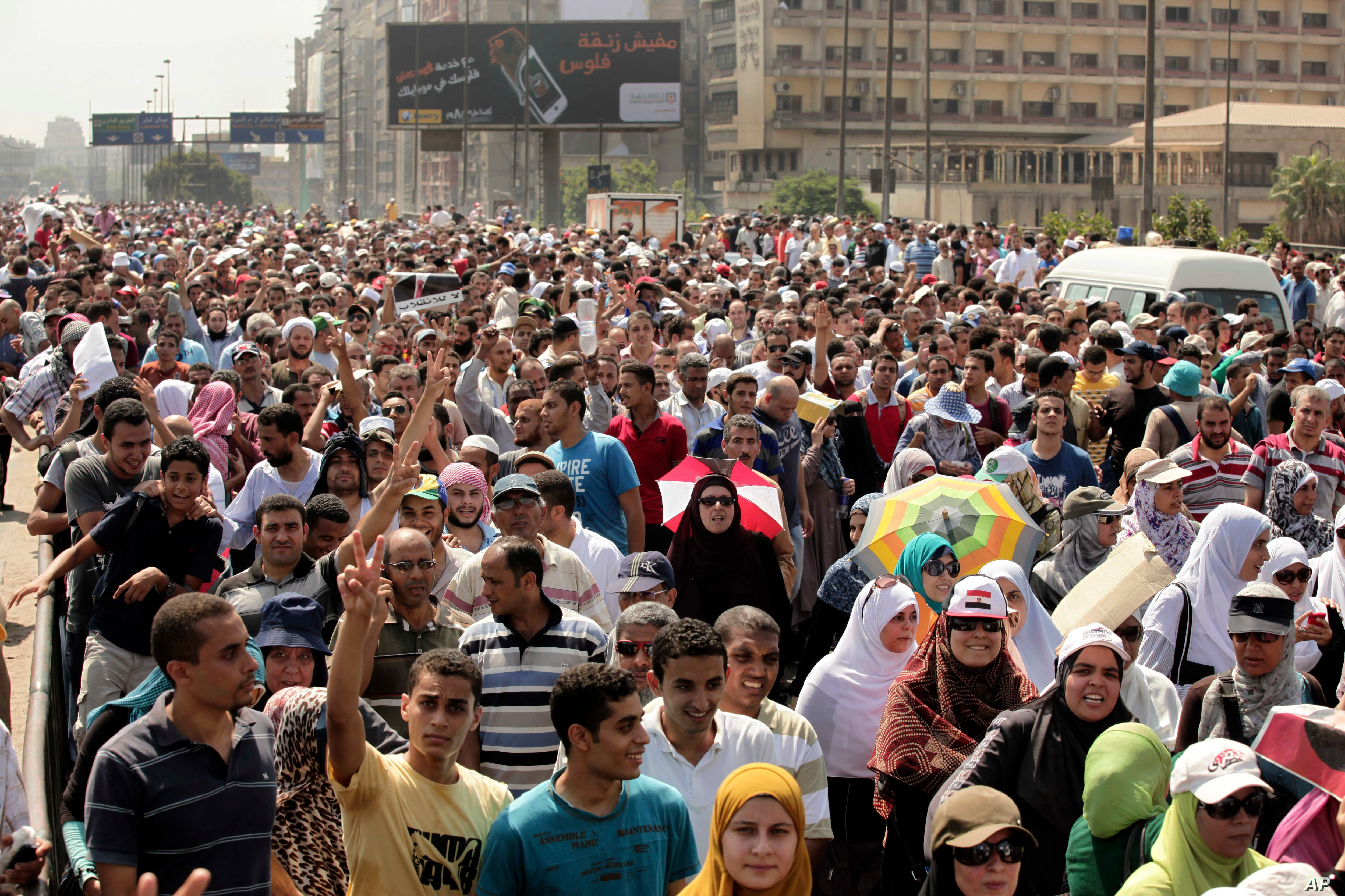 Supporters of ousted Egyptian President Mohamed Morsi cross the Nile as they march towards downtown Cairo from the Mohandeseen neighborhood of Cairo, Egypt, Aug. 16, 2013.